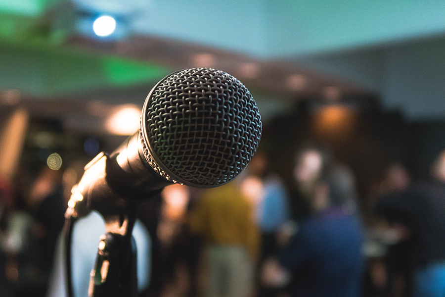Close up of microphone on stage in a pub