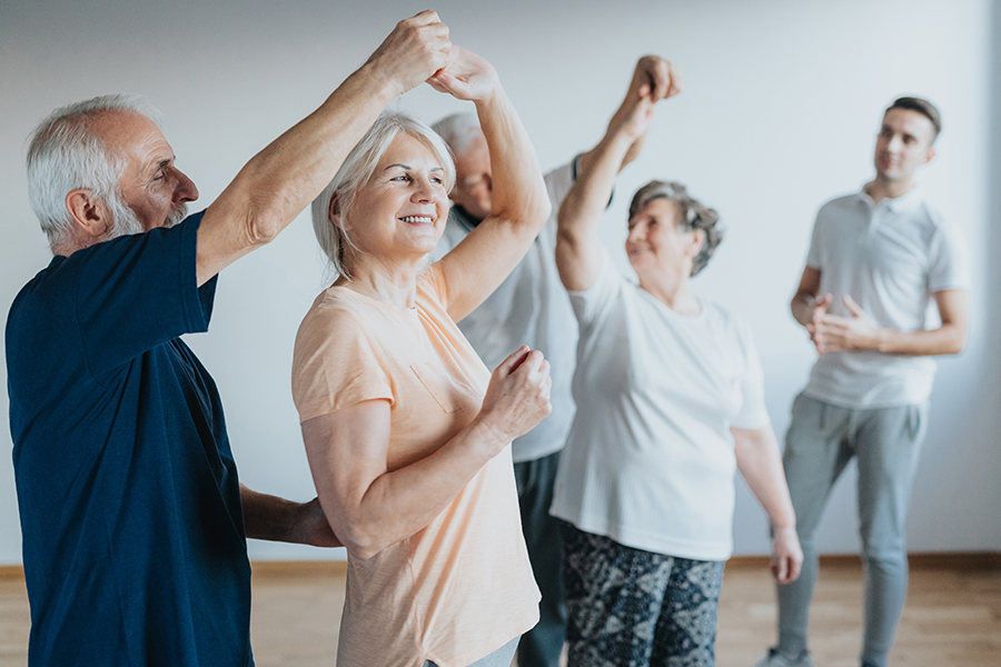 Seniors dancing with their partners during dancing class